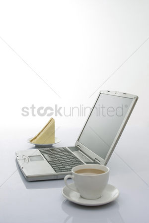 Technology background : Laptop with coffee and sandwich