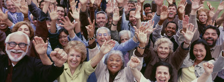 Senior women : Large group of multi-ethnic people cheering with arms raised