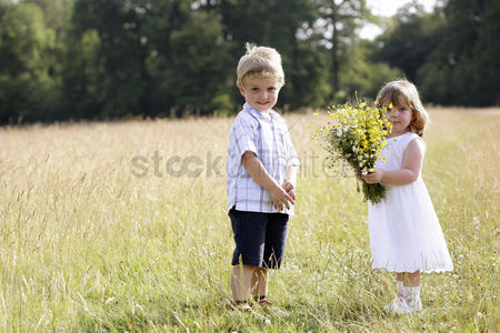 First : Little boy and little girl in the field