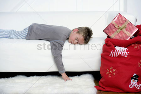 Comfy : Little boy sleeping on the sofa