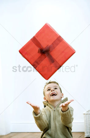 Bliss : Little boy tossing his gift