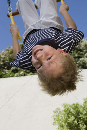 Sets : Little boy upside down on a swing