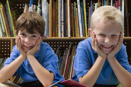 Gaze : Little boys in school library