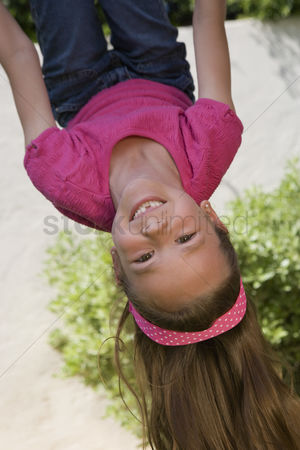 Spirit : Little girl hanging upside down
