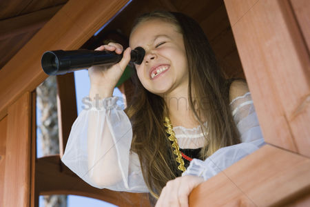 Smile : Little girl playing in a fort