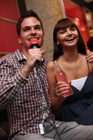 Eastern european ethnicity : Man and woman at karaoke bar