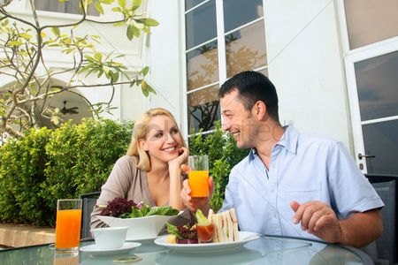 Eastern european ethnicity : Man and woman having a meal at an outdoor restaurant