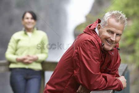 British ethnicity : Man and woman in mountains focus on man leaning on railing