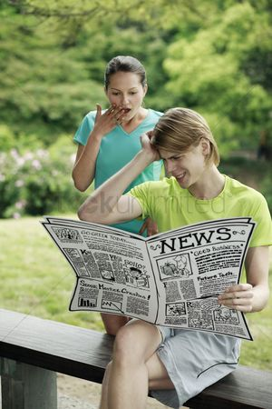 Cardboard cutout : Man and woman reading newspaper