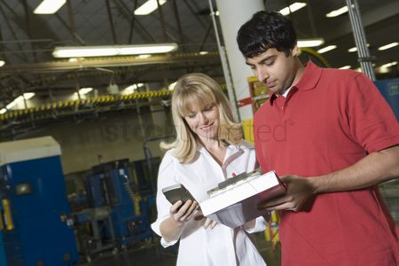 Notepad : Man and woman working in newspaper factory