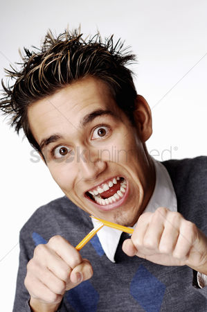 Blow up : Man breaking a pencil