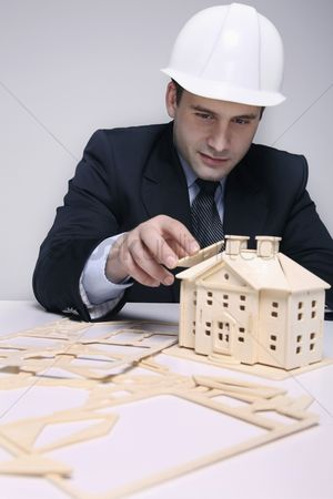 Eastern european ethnicity : Man building a wooden house model