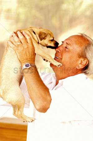 Retirement : Man carrying up his dog