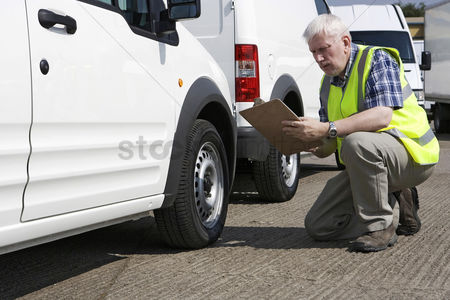 Transportation : Man checking the condition of vehicle