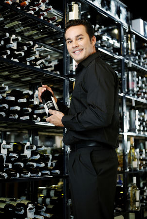 Sets : Man choosing wine in the wine cellar