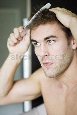Satisfaction : Man combing his hair