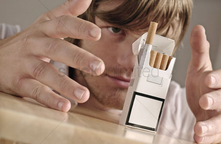Magic : Man controlling a cigarette out from the box with his magical power