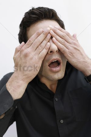 Forbidden : Man covering eyes with hands