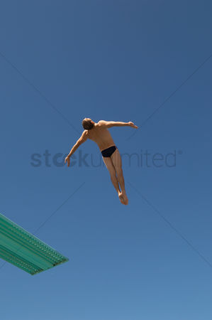 Diving : Man diving from diving board mid air