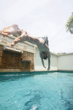 Diving : Man diving into swimming pool