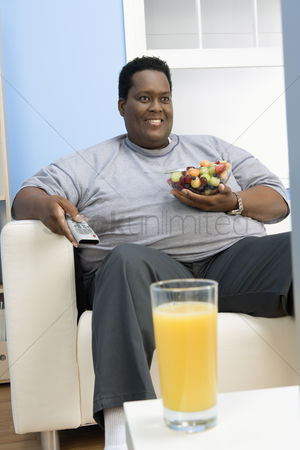 Sets : Man eating bowl of fruit