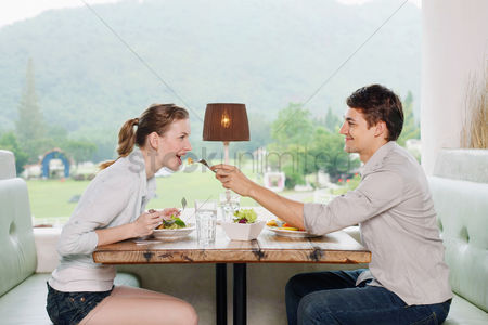 Affectionate : Man feeding woman with food