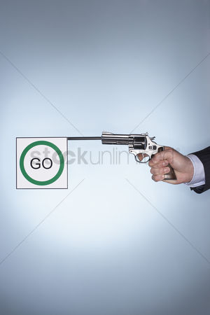 Firing : Man firing pistol with go flag close-up of hand