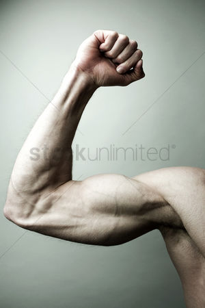 Strong : Man flexing his muscle