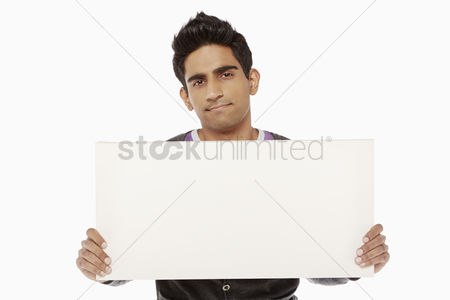 Masculinity : Man holding up a blank placard