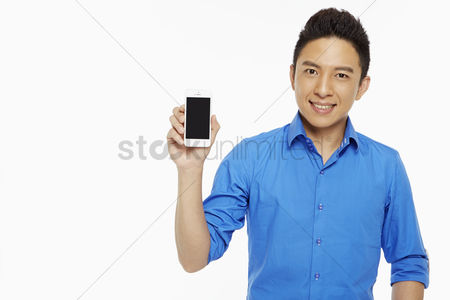 Blank : Man holding up a mobile phone