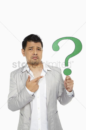 Masculinity : Man holding up a question mark symbol