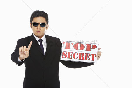 Masculinity : Man holding up a top secret