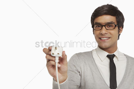 Portability : Man holding up an electrical plug
