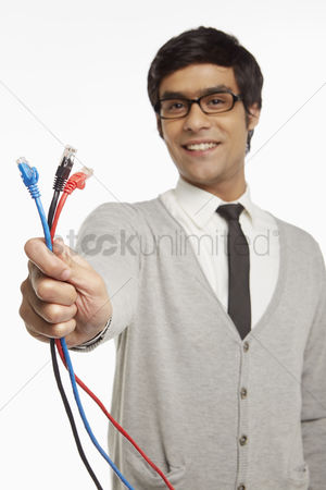Portability : Man holding up three network connection cables