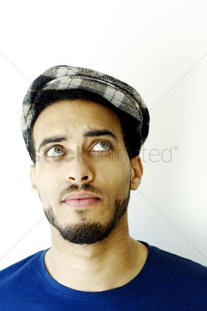 Wondering : Man in beret looking up