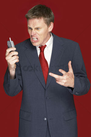 Fury : Man in business suit shouting angrily on the hand phone