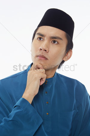 Baju melayu : Man in traditional clothing contemplating