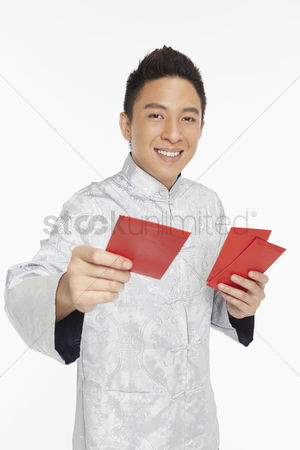 Lunar new year : Man in traditional clothing handing out red packets