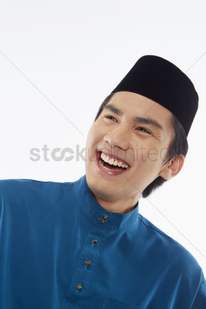 Baju melayu : Man in traditional clothing laughing