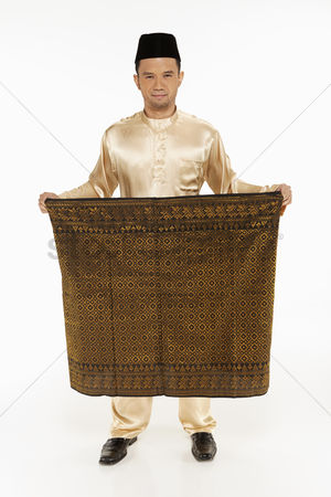 Baju melayu : Man in traditional clothing outing on his sarong
