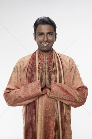 Traditional clothing : Man in traditional clothing showing greeting gesture