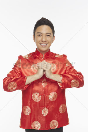 Traditional clothing : Man in traditional clothing showing hand greeting gesture