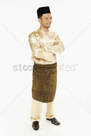 Baju melayu : Man in traditional clothing  standing and smiling
