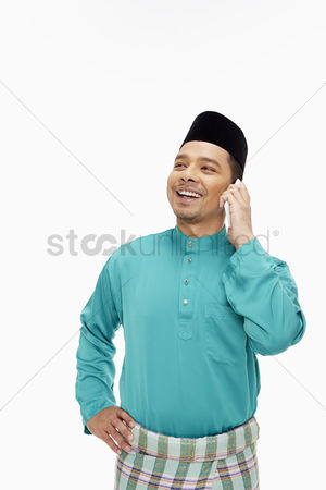 Traditional clothing : Man in traditional clothing talking on mobile phone
