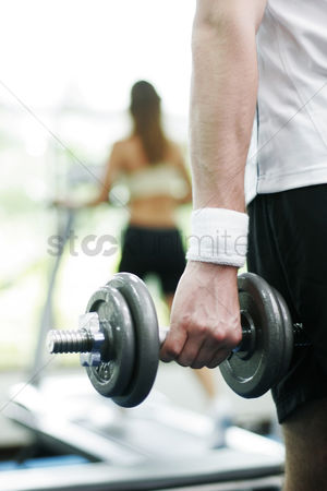 Dumbbell : Man lifting a dumbbell