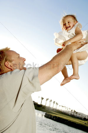 Adorable : Man lifting up his young daughter