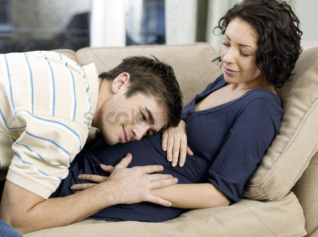 Relaxing : Man listening to his pregnant wife  stomach