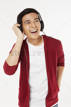 Portability : Man listening to music on the headphone
