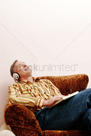 Sitting on lap : Man listening to music while relaxing