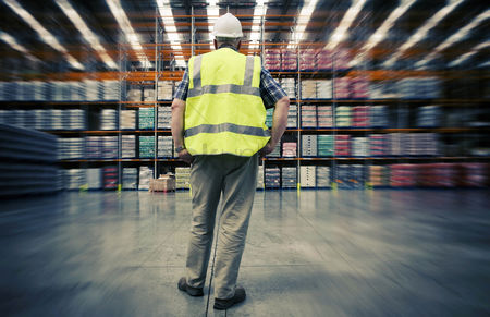 Supervisor : Man looking at warehouse goods